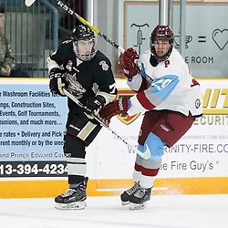 TRENTON, ON - NOV 4:  Brandon Marinelli #7 of the Trenton Golden Hawks and Daniel Tsiampas #29 of the Pickering Panthers during the OJHL regular season game between the  Pickering Panthers and Trenton Golden Hawks on November 4, 2016 in Trenton, Ontario. (Photo by Amy Deroche/OJHL Images)