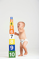 Baby Approaching Tower of Number Blocks