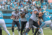 Sunday, October 6, 2019; Charlotte, N.C., USA;  Jacksonville Jaguars running back Leonard Fournette (27) runs with the ball during an NFL game against the Carolina Panthers at Bank of America Stadium. The Carolina Panthers beat the Jacksonville Jaguars 34-27. (Brian Villanueva/Image of Sport)