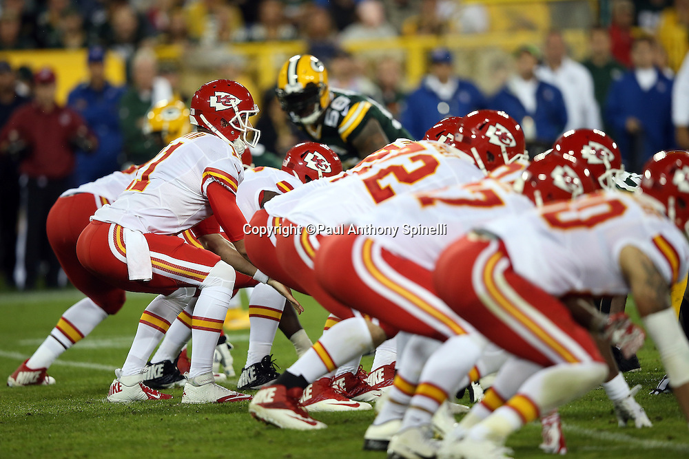 Kansas City Chiefs quarterback Alex Smith (11) gets set to take the snap over center while the offense is lined up at the line of scrimmage during the 2015 NFL week 3 regular season football game against the Green Bay Packers on Monday, Sept. 28, 2015 in Green Bay, Wis. The Packers won the game 38-28. (©Paul Anthony Spinelli)
