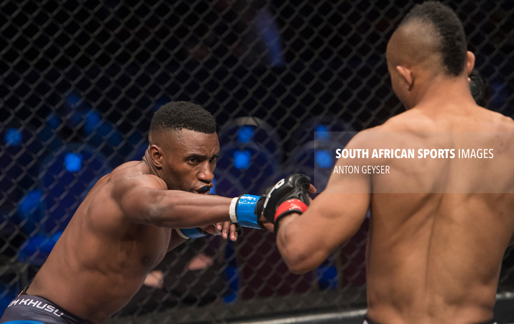 JOHANNESBURG, SOUTH AFRICA - MAY 13: (L-R) TC Khusu punches Guy Mongambi during EFC 59 Fight Night at Carnival City on May 13, 2017 in Johannesburg, South Africa. (Photo by Anton Geyser/EFC Worldwide/Gallo Images)