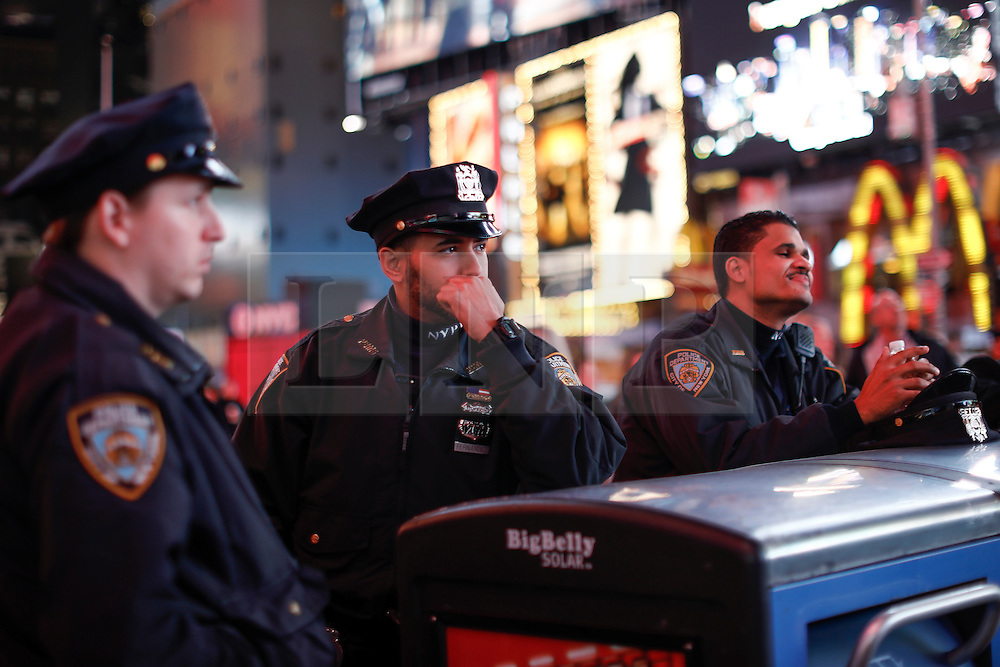 © Licensed to London News Pictures. 09/11/2016. New York City, USA. Police officers watch over as members of the public react to news that Donald Trump looks likely to be elected as the next president of the United States, while gathering in Times Square, New York City, on Wednesday, 9 November. Photo credit: Tolga Akmen/LNP