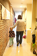 Dana parsely walks down the hall outside her classroom with her student Maralee Antle at the Childhood Development Center. © Ohio University / Photo by Ross Brinkerhoff