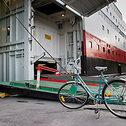 Three weeks aboard the Kong Harald. Hurtigruten, the Coastal Express. Portelone of the ship, and a bike.