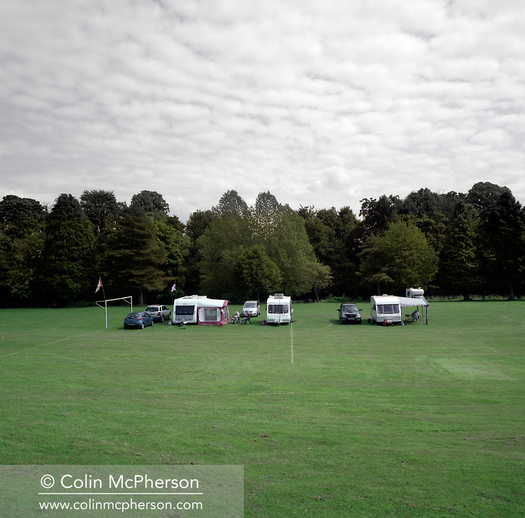 'Campsite, Canonbie, 2013'  from 'A Fine Line - Exploring Scotland's Border with England' by Colin McPherson.<br /> <br /> Caravanning is a British obsession and this campsite in the heart of the so-called Debatable lands hosts holidaymakers from both Scotland and England, making it look like a football match between the Scots and the Auld Enemy<br /> <br /> The project was a one-year exploration of the border between the two historic nations, as seen from the Scottish side of the frontier.<br /> <br /> Colin McPherson is a photographer and visual artist based in north west England. In 2012 he was one of the founding members of Document Scotland, a collective of four Scottish documentary photographers brought together by a common vision to witness and photograph the important and diverse stories within Scotland at one of the most important times in our nation's history.<br /> <br /> 'A Fine Line' will be shown for the first time in public at Impressions Gallery, Bradford, from July 1 until September 27, 2014 to coincide with the Scottish Independence referendum.