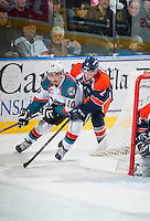 KELOWNA, CANADA - FEBRUARY 18: Nick Merkley #10 of Kelowna Rockets attempts a wrap around goal while being checked by Travis Verveda #2 of Kamloops Blazers on February 18, 2015 at Prospera Place in Kelowna, British Columbia, Canada.  (Photo by Marissa Baecker/Shoot the Breeze)  *** Local Caption *** Nick Merkley; Travis Verveda;