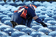 A Chicago Bears fan brushes snow off his seat on a cold weather day before the Chicago Bears 2016 NFL week 15 regular season football game against the Green Bay Packers on Sunday, Dec. 18, 2016 in Chicago. The Packers won the game 30-27. (©Paul Anthony Spinelli)