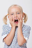 Portrait of a surprised girl with mouth open over white background