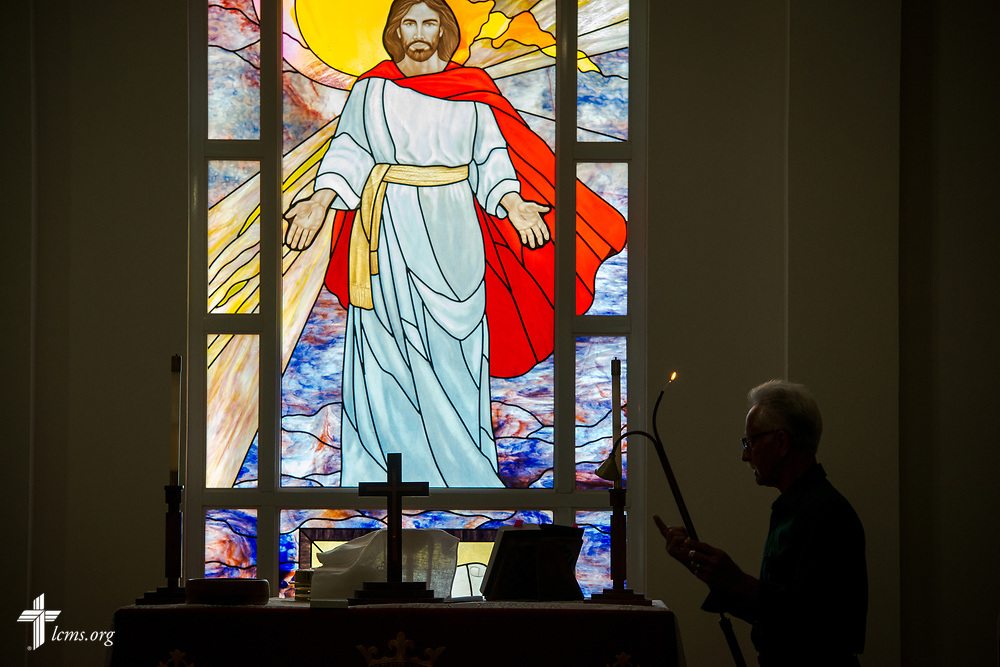 Congregation member Gilberto Valentin lights the altar candles before worship at Iglesia Luterana Principe de Paz (Prince of Peace Lutheran Church), Mayagüez, Puerto Rico, on Sunday, April 15, 2018. LCMS Communications/Erik M. Lunsford