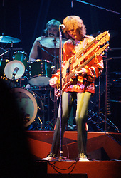 Yes performing at the New Haven Coliseum on 9 August 1977 Alan White on Drums & Chris Squire playing the Triple Neck Guitar. Credit Photograph: James R Anderson, New Haven CT