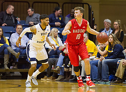 Dec 20, 2016; Morgantown, WV, USA; Radford Highlanders guard Caleb Tanner (10) dribbles while defended by West Virginia Mountaineers guard James Bolden (3) during the second half at WVU Coliseum. Mandatory Credit: Ben Queen-USA TODAY Sports