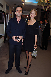 The HON.PHILIP & WENDY KNATCHBULL at the Sotheby's Summer Party 2007 at their showrooms in New Bond Street, London on 4th June 2007.<br />