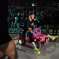 C.J. Gettys of the UNCW men's basketball team arrives on a pink toy jeep at Friday night's midnite madness at Trask Coliseum.  Mike Spencer/StarNews