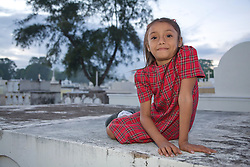 Central America, Nicaragua, Granada. Young girl at cemetery during Day of the Dead celebration (Dia de los Muertos).