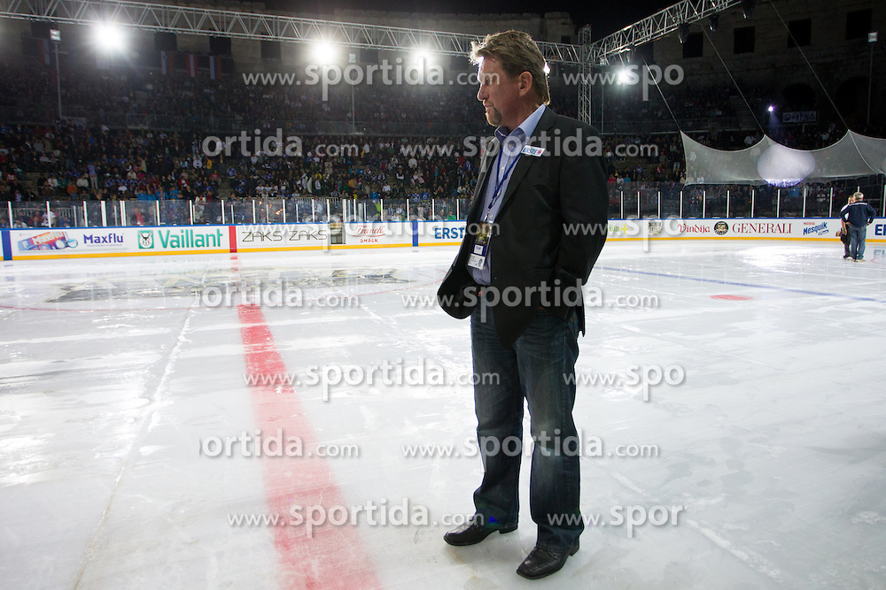 14.09.2012. Pula Arena, Pula, CRO, EBEL, KHL Medvescak Zagreb vs HDD Telemach Olimpija Ljubljana, 03. Runde, in picture Heikki Malkia, head coach of HDD Telemach Olimpija, checking the ice as the game is delayed because of the problems with ice before the Erste Bank Icehockey League 3rd Round match between KHL Medvescak Zagreb and HDD Telemach Olimpija Ljubljana at the Pula Arena, Pula, Croatia on 2012/09/14. (Photo By Matic Klansek Velej / Sportida)