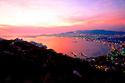 MEXICO, PACIFIC COAST, GUERRERO, TOURISM Acapulco; overview of the entire Bay of Acapulco with the Isla de la Roqueta at the bay entrance