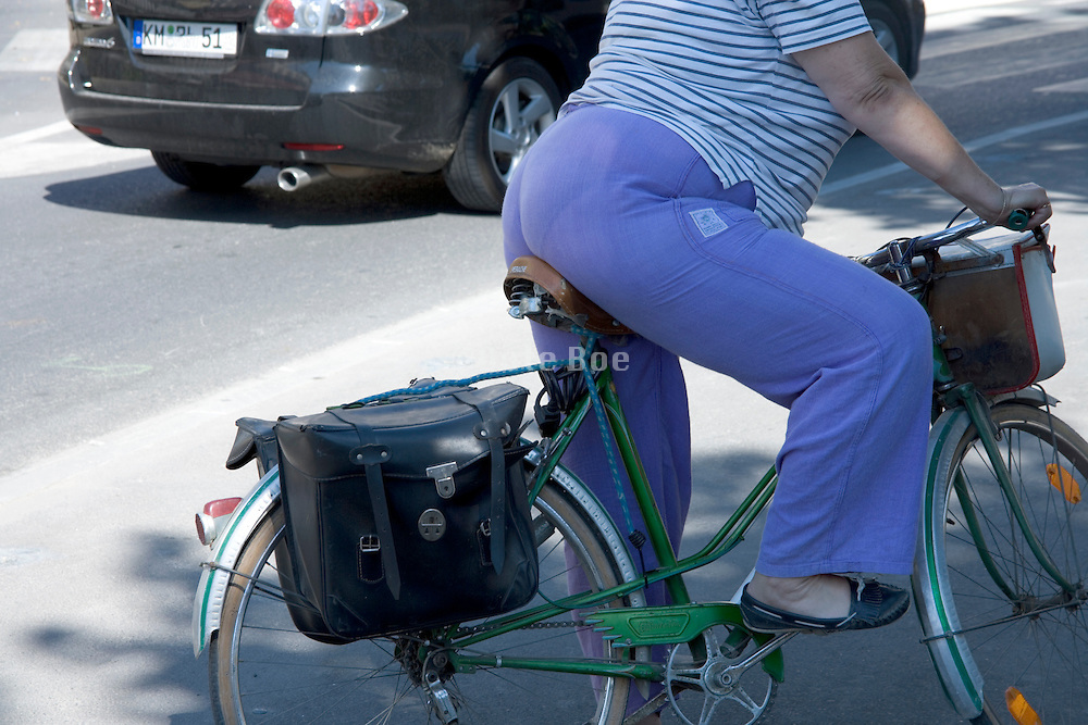 a sturdy woman riding a bike