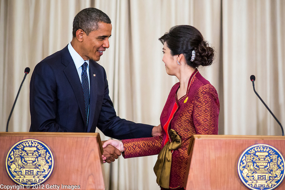 18 NOVEMBER 2012 - BANGKOK, THAILAND: US President Barack Obama and Thai Prime Minister Yingluck Shinawatra shake hands and say goodbye after the joint press conference with President Obama and Prime Minister Shinawatra in Government House on November 18, 2012 in Bangkok, Thailand. Obama will become the first serving US President to visit Myanmar during his four-day tour of Southeast Asia that will also include visits to Thailand and Cambodia.  (  PHOTO BY JACK KURTZ