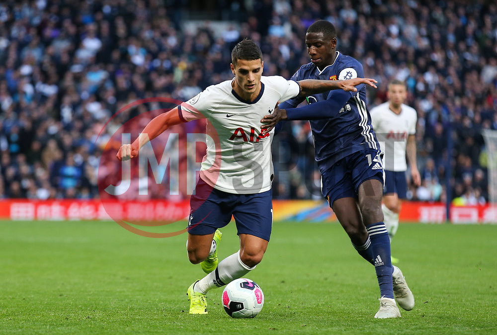 Erik Lamela of Tottenham Hotspur and Abdoulaye Doucoure of Watford tussle for the ball  - Mandatory by-line: Arron Gent/JMP - 19/10/2019 - FOOTBALL - Tottenham Hotspur Stadium - London, England - Tottenham Hotspur v Watford - Premier League-