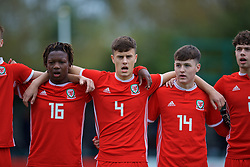 NEWPORT, WALES - Monday, October 14, 2019: Wales' (L-R) Tivonge Rushesha, Sam Bowen and Harry Pinchard line-up for the national anthem before an Under-19's International Friendly match between Wales and Austria at Dragon Park. (Pic by David Rawcliffe/Propaganda)