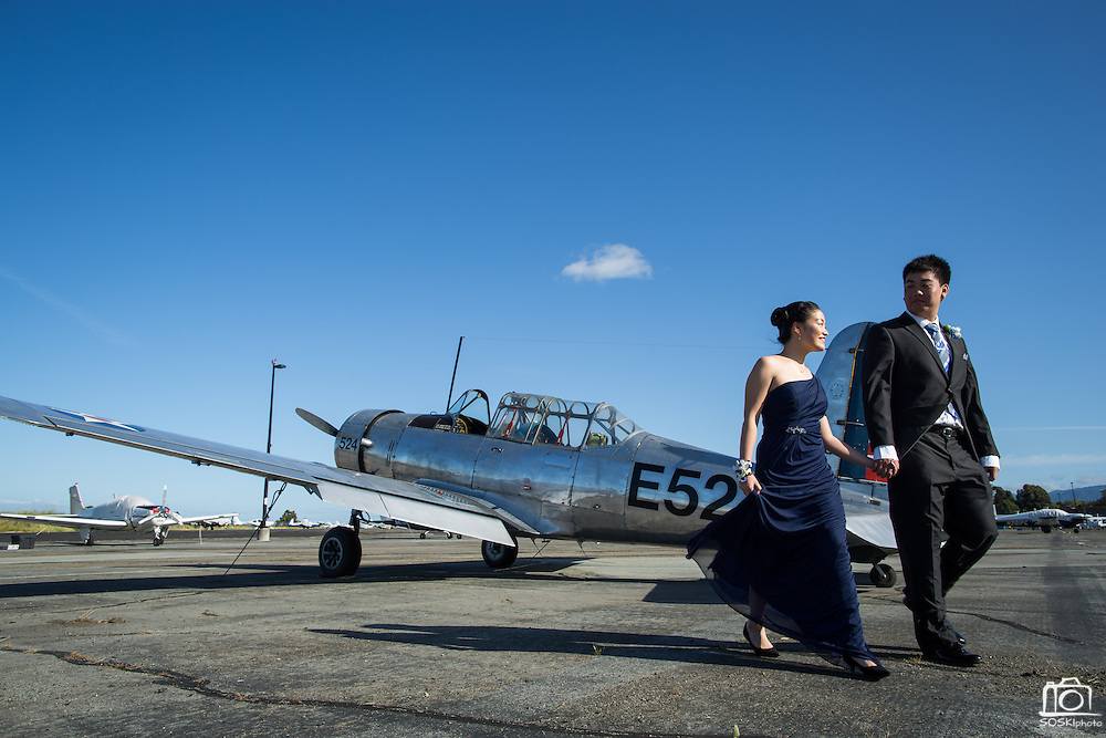 A couple poses for prom portraits at the Palo Alto Airport in Palo Alto, California, on April 23, 2016. (Stan Olszewski/SOSKIphoto)