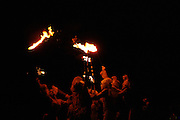 Fire dancers joining flames at Marking the Summer Solstice on the University of Arizona campus in Tucson.