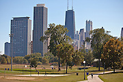 Activities in Lincoln Park with the Chicago skyline.