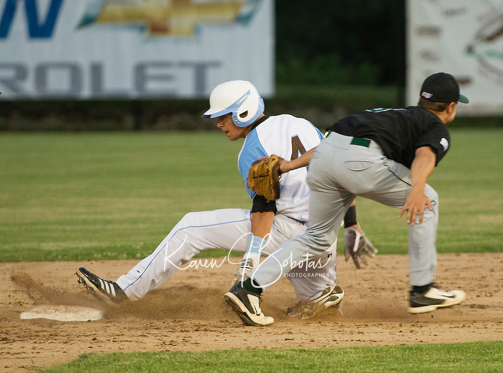 Matt Byrne is tagged out by Brett Charbonneau during Wednesday nights Muskrats game with the Vermont Mountaineers under the lights at Robbie Mills Field.  (Karen Bobotas/for the Laconia Daily Sun)