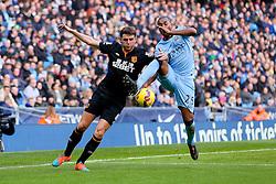 Hull City's Alex Bruce challenges Manchester City's Fernandinho - Photo mandatory by-line: Matt McNulty/JMP - Mobile: 07966 386802 - 07/02/2015 - SPORT - Football - Manchester - Etihad Stadium - Manchester City v Hull City - Barclays Premier League