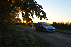 © under license to London News Pictures.  25-10-2010 A car drives through rural Leicestershire under the rising sun this Monday morning. After a warm start to Autumn, forecasters predict the cold spell to last until midweek.