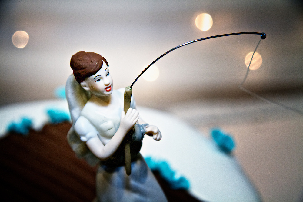 Hook Line and Sinker: A thematic wedding cake; what a cake topper! The bride has caught her groom hook, line and sinker. The newlyweds met on the online dating site, Plenty of Fish.