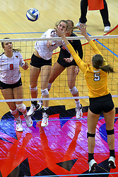 23 November 2017:  Stef Jankiewicz watches as Allie Line attacks past Sydney Bronner during a college women's volleyball match between the Valparaiso Crusaders and the Illinois State Redbirds in the Missouri Valley Conference Tournament at Redbird Arena in Normal IL (Photo by Alan Look)