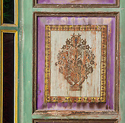 Painted window frame with an extremely rare use of the colour lilac, from the Courtyard of the Harem, Glaoui Palace, early 19th century, in Fes, Fes-Boulemane, Northern Morocco. The room has a central fountain, zellige tilework and a carved balcony which is damaged and in need of restoration. Thami Glaoui, Pasha of Marrakech, used this as his Fes residence. The complex consists of 30 fountains, 17 houses, 2 hammams, an oil mill, a mausoleum and cemetery, a madrasa, gardens and stables. Picture by Manuel Cohen