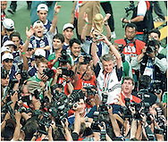 France's team coach Jacquet Aime (C) holds up the trophy after winning by 3-0 to Brazil, at Saint Dennis Stadium in Paris, France,on July 12, 1998.  (Alejandro PAGNI/PHOTOXPHOTO)