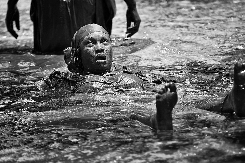 Bassin St. Jacques (the sacred pool), during the annual voodoo festival in Plaine Du Nord. The festival mixes both voodoo and Catholic elements, honouring both St. Jacques and Ogun, the voodoo god of war.