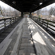 4/12/11 -- BRUNSWICK, Maine.  The Black Bridge is closed for repairs. The aging bridge has several new sections of fencing along the lower wooden span, but - for the most part appears to be in disrepair. Photo by Roger S. Duncan.