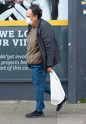©Licensed to London News Pictures 20/03/2020<br /> New Eltham, UK. A shopper wearing a protective face mask. Coronavirus threat. People out and about at their local shops in New Eltham, South East London. Photo credit: Grant Falvey/LNP