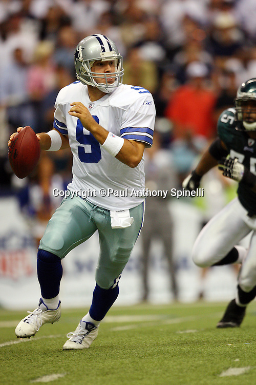IRVING, TX - SEPTEMBER 15:  Quarterback Tony Romo #9 of the Dallas Cowboys rolls to his right while looking downfield for a receiver during the game against the Philadelphia Eagles at Texas Stadium on September 15, 2008 in Irving, Texas. The Cowboys defeated the Eagles 41-37. ©Paul Anthony Spinelli *** Local Caption *** Tony Romo