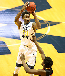Dec 16, 2017; Morgantown, WV, USA; West Virginia Mountaineers forward Wesley Harris (21) shoots a three pointer during the first half against the Wheeling Jesuit Cardinals at WVU Coliseum. Mandatory Credit: Ben Queen-USA TODAY Sports