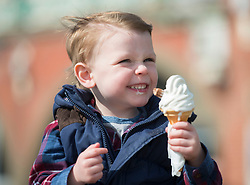 © Licensed to London News Pictures. 29/03/2014. Brighton, UK. 3 year old Chalie Watson enjoys an ice cream.  People enjoy the sunny weather in Brighton today 29th March 2014. The warm weather is forecast to remain into next week. Photo credit : Stephen Simpson/LNP