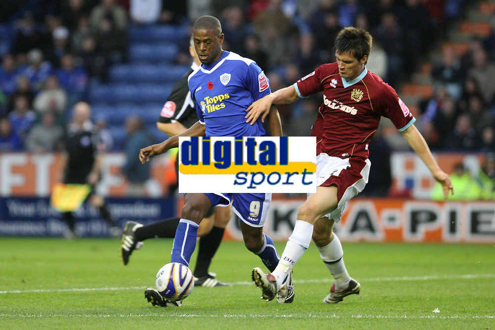 Photo: Pete Lorence/Sportsbeat Images.<br />Leicester City v Burnley. Coca Cola Championship. 10/11/2007.<br />Carl Cort clears the ball from Stephen Jordan.
