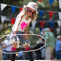 Ella Smith of Santa Cruz, CA tries her hand at roping while watching the rodeo.