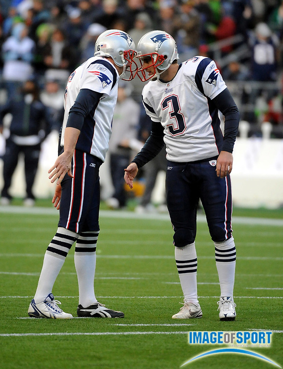 Dec 7, 2008; Seattle, WA, USA; New England Patriots kicker Stephen Gostkowski (3), right and holder Chris Hanson (5) bump heads in celebration during the Patriots 24-21 victory over the Seattle Seahawks at Qwest Field.