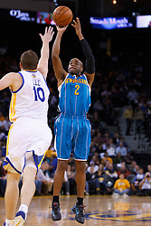 Mar 28, 2012; Oakland, CA, USA;  New Orleans Hornets point guard Jarrett Jack (2) shoots over Golden State Warriors power forward David Lee (10) during the first quarter at Oracle Arena. Mandatory Credit: Jason O. Watson-US PRESSWIRE