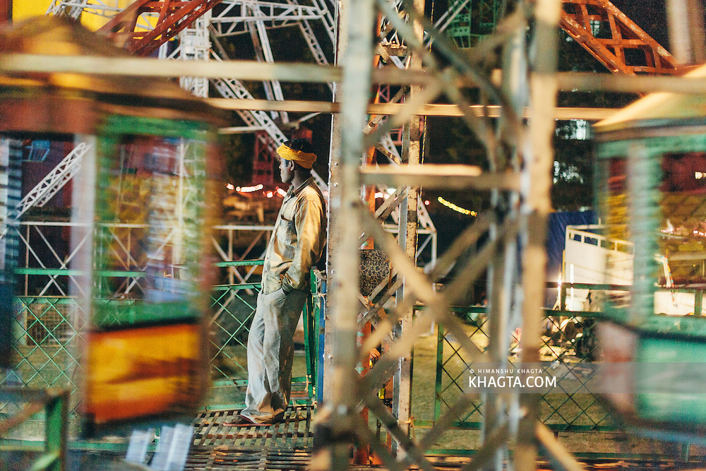 An operator at the carvinal waiting for his customers at Dhalpur Ground. Kullu Dussehra is the Dussehra festival observed in the month of October in Himachal Pradesh state in northern India. It is celebrated in the Dhalpur maidan in the Kullu valley. Dussehra at Kullu commences on the tenth day of the rising moon, i.e. on 'Vijay Dashmi' day itself and continues for seven days. Its history dates back to the 17th century when local King Jagat Singh installed an idol of Raghunath on his throne as a mark of penance. After this, god Raghunath was declared as the ruling deity of the Valley.