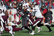 LITTLE ROCK, ARKANSAS - NOVEMBER 23:  Tyler Russell #17 of the Mississippi State Bulldogs pitches the ball to a running back against the Arkansas Razorbacks at War Memorial Stadium on November 23, 2013 in Little Rock, Arkansas.  The Bulldogs defeated the Razorbacks 24-17.  (Photo by Wesley Hitt/Getty Images) *** Local Caption *** Tyler Russell