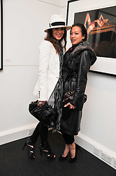 Left to right, LARA BOHINC and ROSEY CHAN at a private view of an exhibition of photographs by Mike Figgis entitled 'Kate & Other Women' held at The Little Black Gallery, 13 A Park Walk, London SW10 on 22nd June 2011.