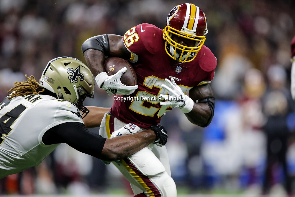 Oct 8, 2018; New Orleans, LA, USA; Washington Redskins running back Adrian Peterson (26) is tackled by New Orleans Saints defensive end Cameron Jordan (94) during the first quarter at the Mercedes-Benz Superdome.