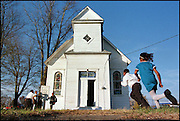 Children from the St. Stephens AME church play tag outside after an Sunday afternoon service in Hanover. The children use the old sign as their base.