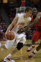 11 December 2010: Jon Ekey works inward guarded by Paul Carter during an NCAA basketball game between the Illinois - Chicago Flames (UIC) and the Illinois State Redbirds (ISU) at Redbird Arena in Normal Illinois.